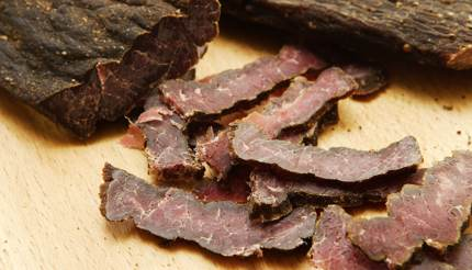 Biltong on wooden board