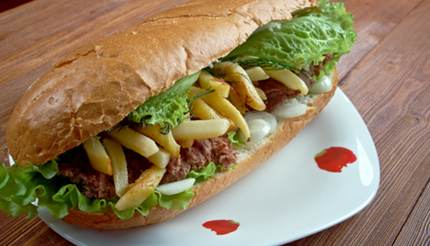 Gatsby sandwich - french fries, meat, lettuce and onions