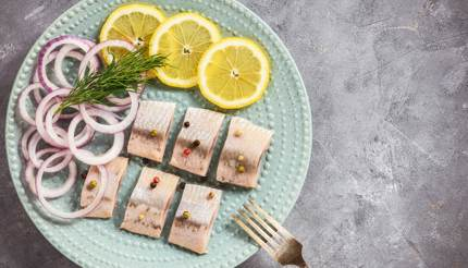 Pickled Herring with lemon slices and red onions