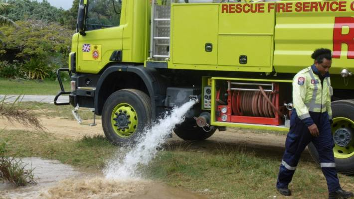 Niue's Fire Service has an ongoing job: keep Trevor's puddle filled up.