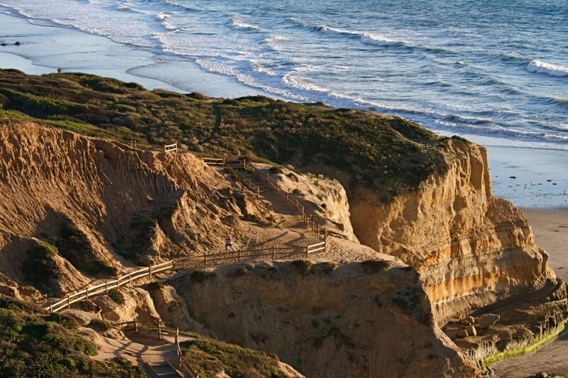 A stunning view of a cliff overlooking a beach outside of San Diego