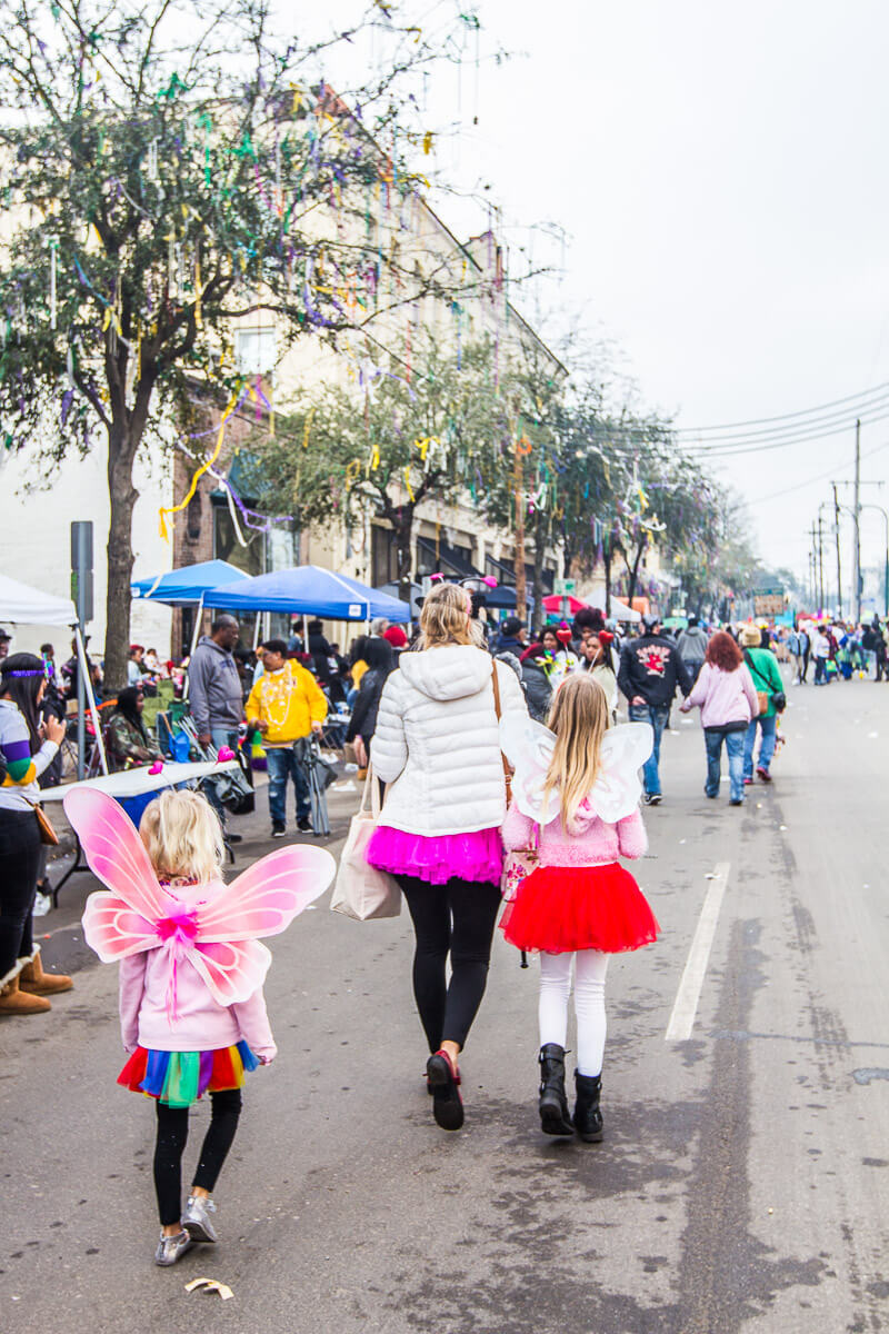 Walking along St, Charles Avenue in New Orleans during Mardi Gras