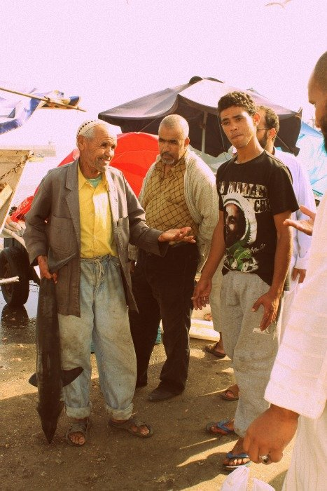 Man selling a shark in Essaouira Morocco makes a deal