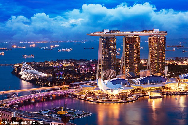 Cheap flights to Singapore (pictured) start from $135 from Perth with Scoot