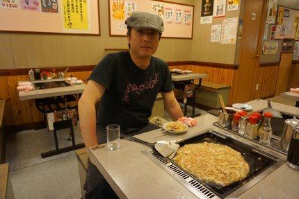 Man eating Monjayaki in Tsukishima