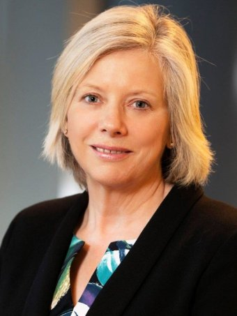 Professional headshot of surf coast shire councillor Heather Wellington who has blonde hair and is wearing  a dark jacket