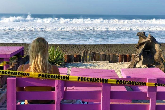 A surfer eyes the break at Playa el Paredon, Guatemala, shortly before the nationwide lockdown was announced in March 2020.