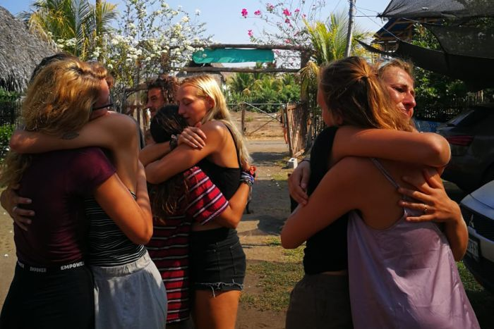 A group of friends hug goodbye in Guatemala.