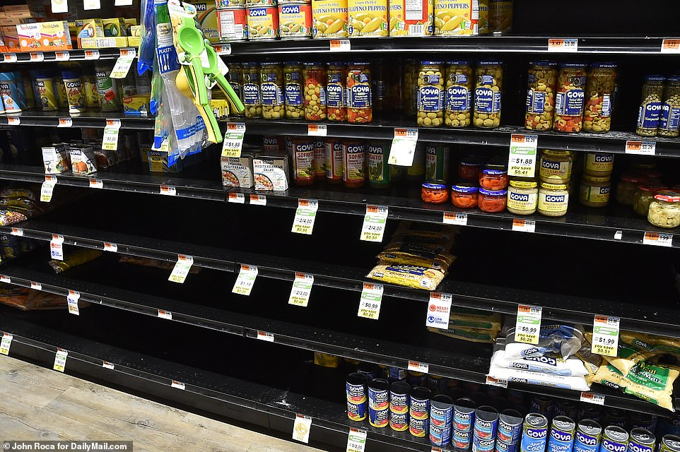 Half-empty shelves are seen at the Best Market in Westhampton Beach on Tuesday