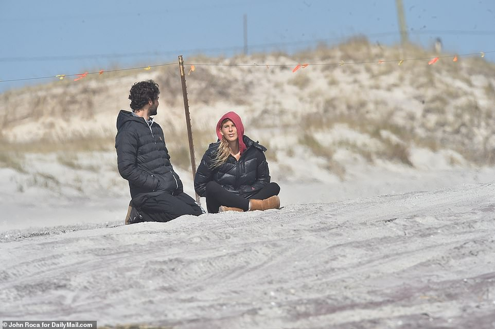The leaders of four Hamptons communities wrote to New York Governor Andrew Cuomo on Friday urging him to take action and ban New York City residents coming to the East End. A couple are seen on an empty beach in Hampton Bays on Tuesday