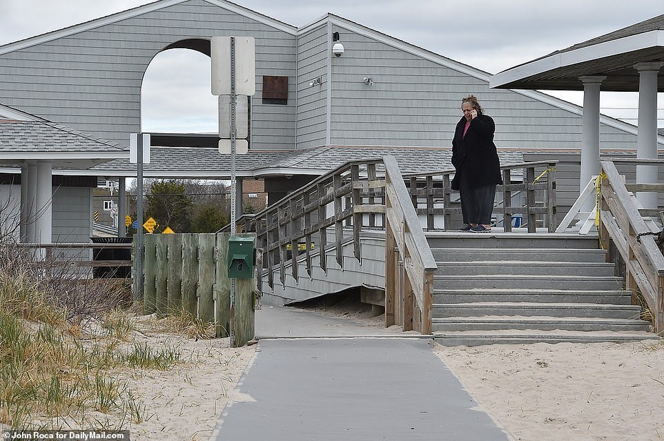 In the Hamptons, real estate agents have seen a spike in demand for rentals that aren't normally sought after until closer to summer. A woman is seen outside Rogers Beach in Westhampton on Tuesday