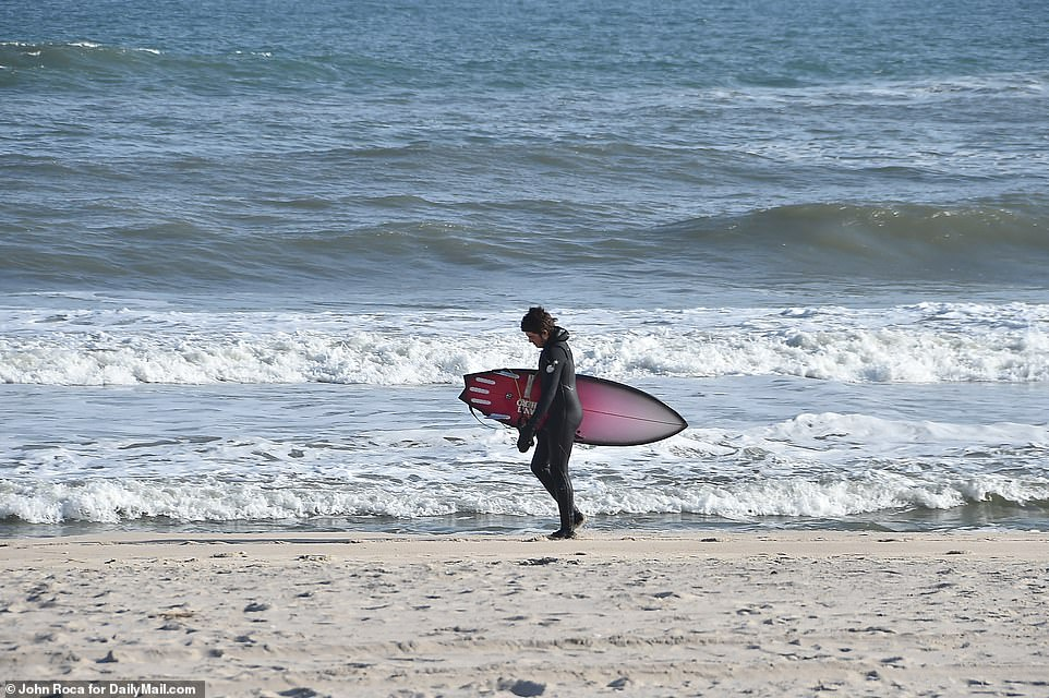 Surfers continue to hit the beach in Southampton despite concerns of coronavirus spread with an influx of New Yorkers