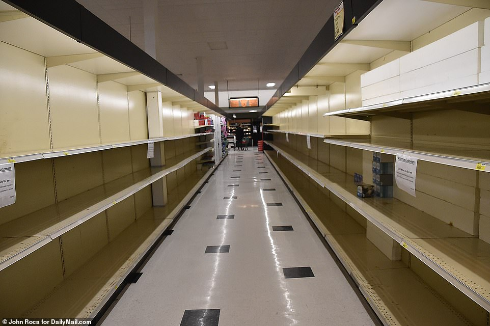 Empty selves in King Kullen in Bridgehampton on Tuesday as New Yorkers fleeing from the coronavirus hotspot are putting more pressure on grocery stores and locals struggle to find the supplies they need because of dwindling supplies