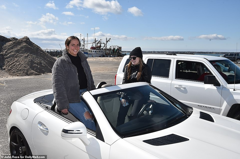 Kristen Bonner and Carla Litto relaxing in their convertible MB on the Shinnecock Inlet on Tuesday. Locals in vacation destinations popular with New Yorkers are concerned that they are bringing increased risk of the coronavirus with them