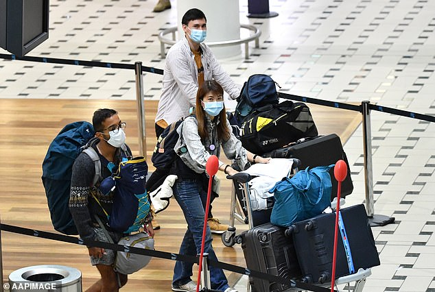 Australians evacuated from South America during the COVID-19 pandemic are seen after landing at Brisbane airport on April 14 (pictured)