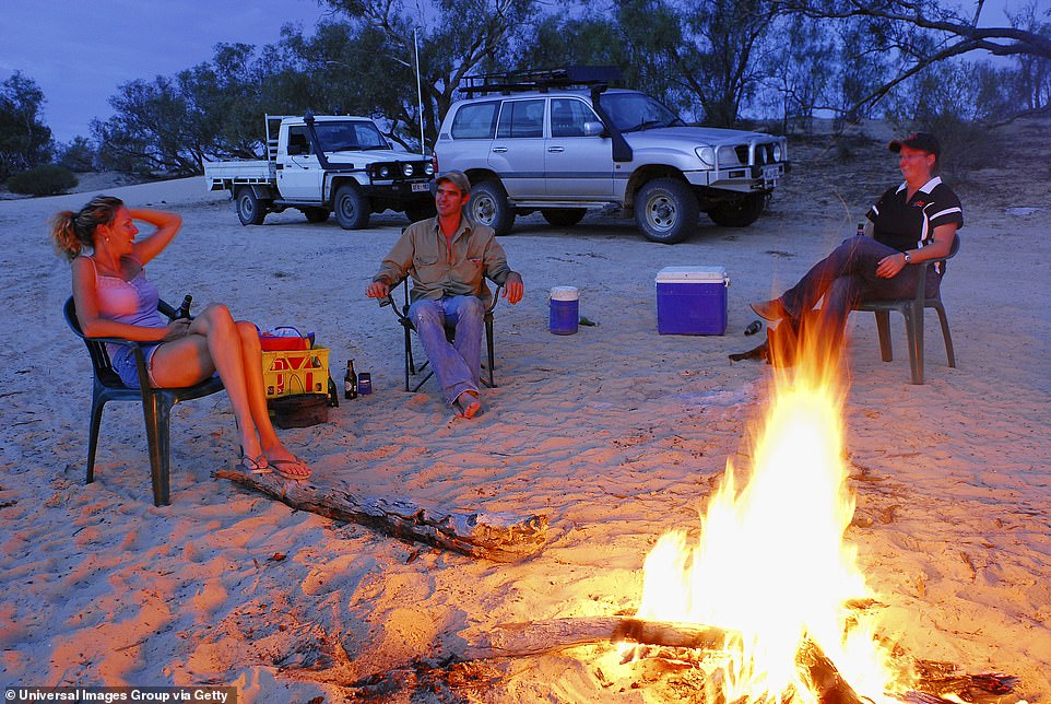 Holidaymakers will begin camping again and enjoying each other's company around a fire in the wake of coronavirus (pictured, friends camping in Kalamurina Station Wildlife Sanctuary in north-east South Australia