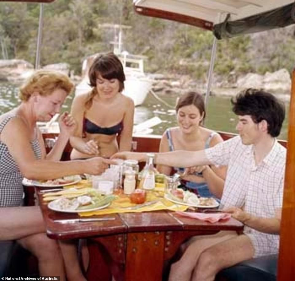 A family enjoy lunch with one another at Pittwater, New South Wales, in 1970 (pictured) with modern families set to return to a similar set of values, after the coronavirus pandemic 'adjusted our priorities', experts said