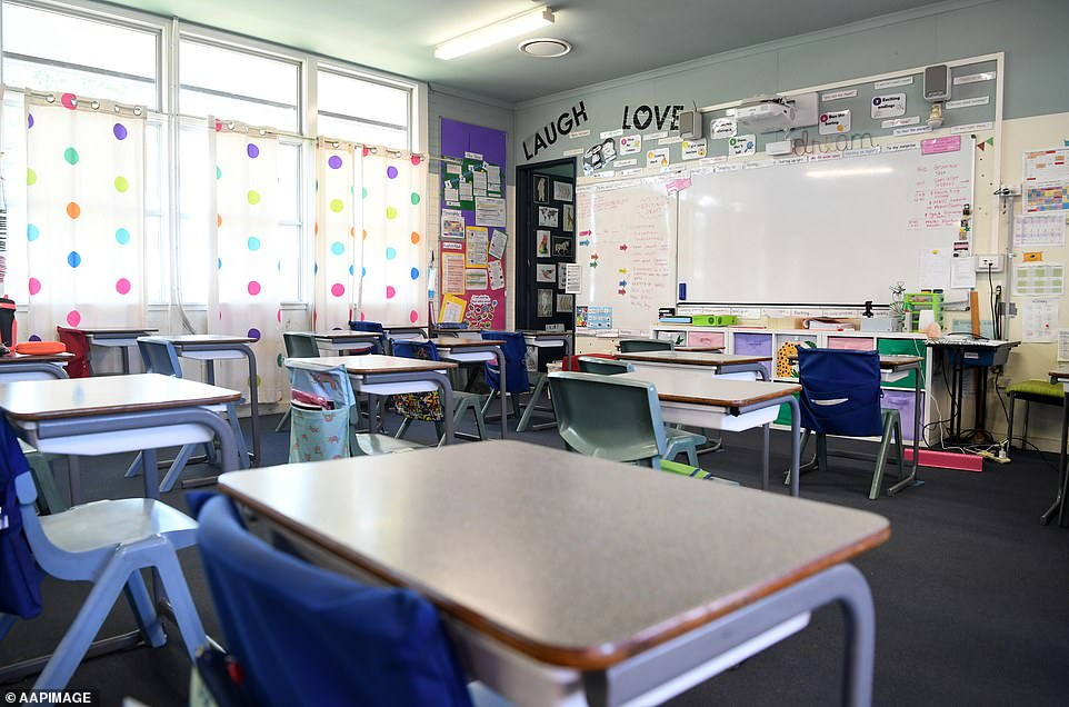 An empty classroom is seen at a primary school in Brisbane on March 3 (pictured) after schools were shutdown during the pandemic