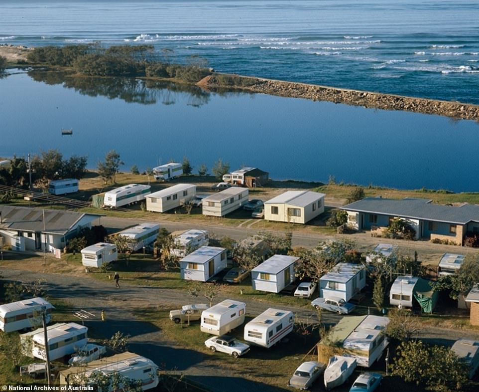 Australians, forced to abandon foreign travel because of the coronavirus, could soon find themselves enjoying simple caravan holidays (pictured, a caravan park at Nambucca Heads in 1975)