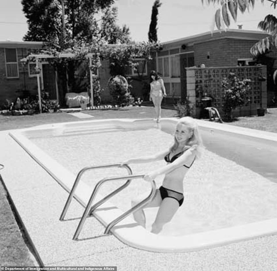A young woman is seen enjoying the swimming pool in the garden of her suburban Perth home in 1972 (pictured), with Australians now looking outside major cities for homes with more space and sunshine