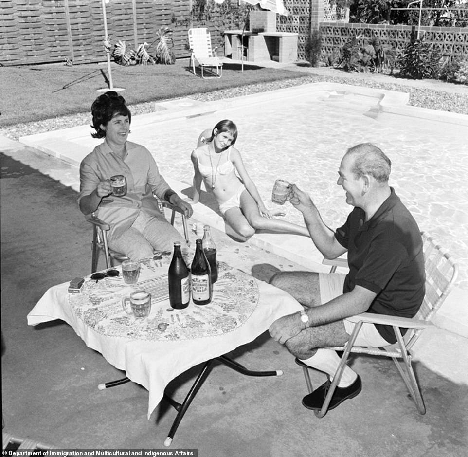 A family in suburbnan Perth are seen enjoying drinks in their garden in 1970 (pictured), with families now also looking to socialise at home with loved ones