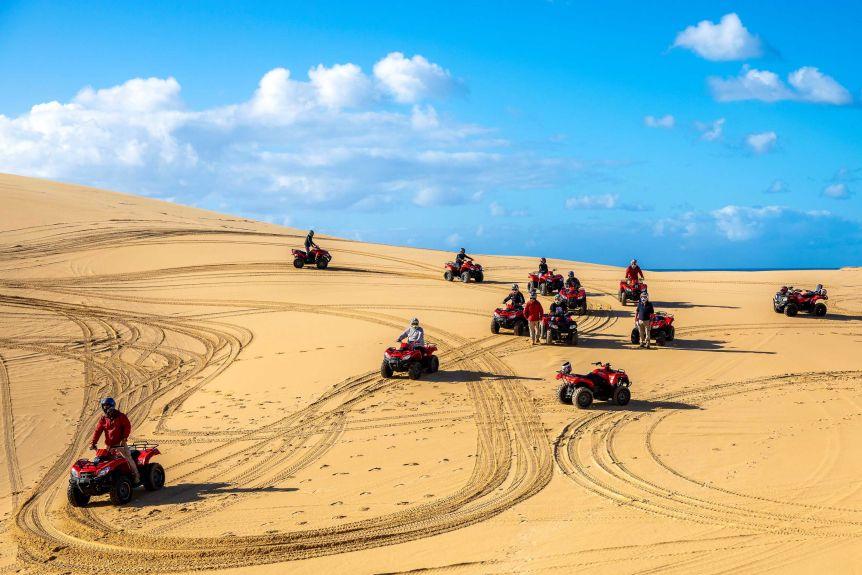 Quad bike riders on sand hills