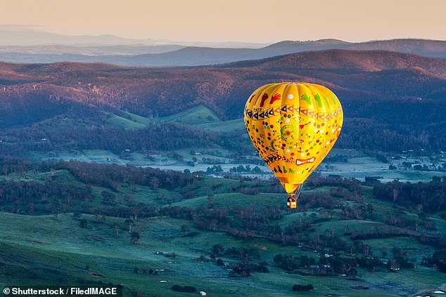 Wotif Managing Director Daniel Finch said the figures revealed road trip destinations were the most popular option as state and territories move to loosen COVID-19 restrictions and allow intrastate travel. Pictured:A sunrise hot air balloon flight over the Yarra Valley in Victoria
