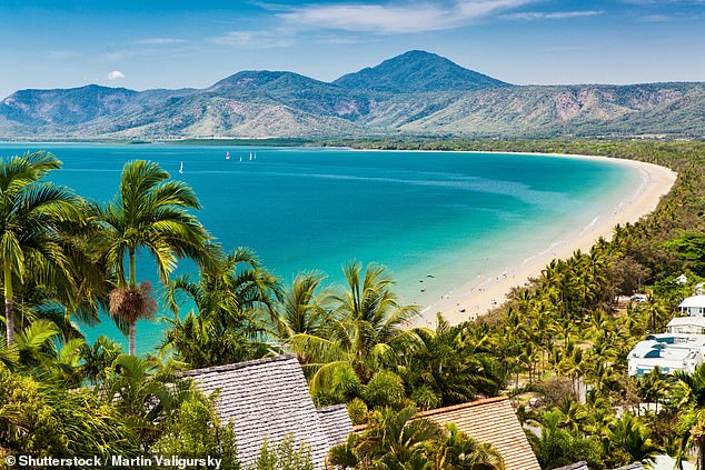 Australians eager to take a well-deserved vacay during the coronavirus pandemic have jumped online in record numbers as domestic travel restrictions look to be eased. Pictured:Port Douglas beach in Queensland