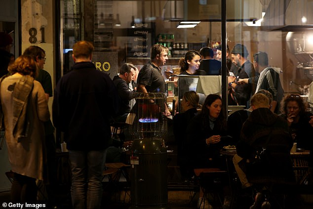 A busy Cairo restaurant in Sydney is seen on Friday night (pictured) as enthusiastic diners flocked out in the city