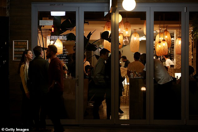 A bustling restaurant is seen in Sydney's Newtown on Friday night as restrictions continued to ease (pictured)