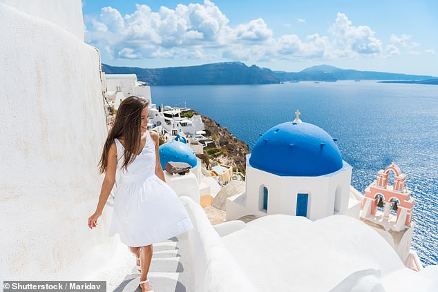 Trips to destinations such as Santorini, in Greece (pictured), may be off the cards until July 2021