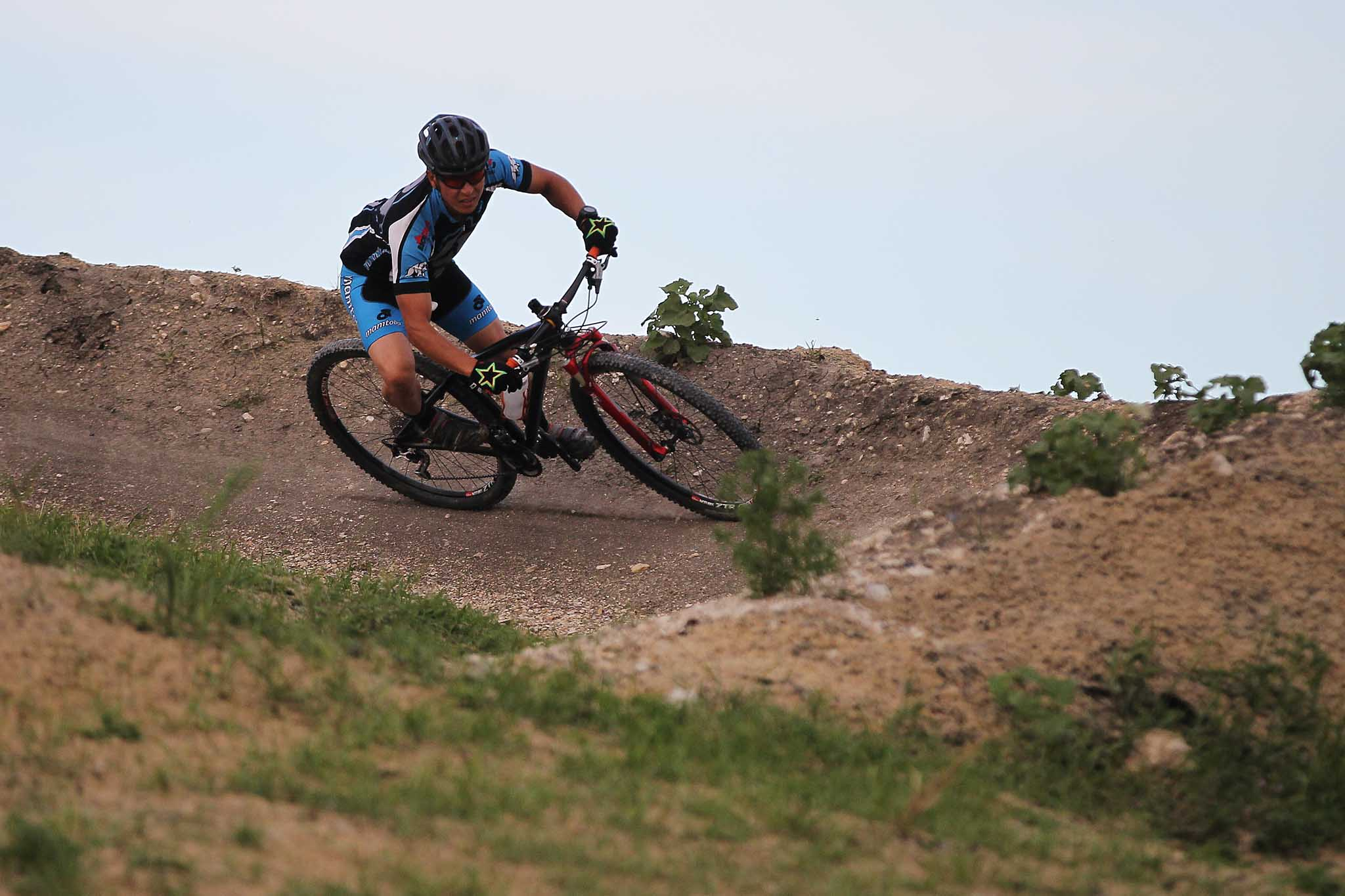 Alex Man makes his way around a berm at Bison Butte in 2016, a course he helped design.
