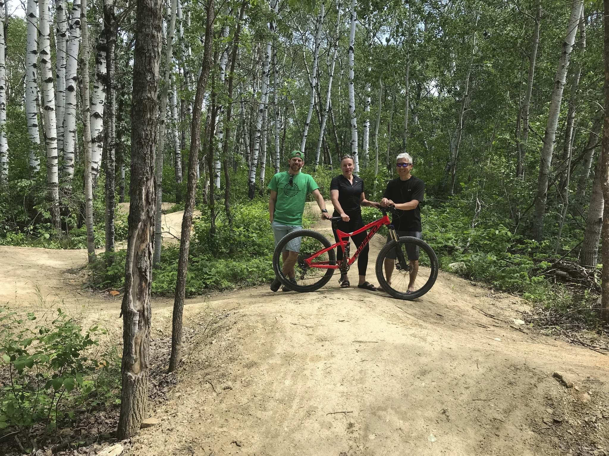 Swanton (left), Dauphin tourism co-ordinator Melissa Stefinew and Man at Northgate flow trail.</p>