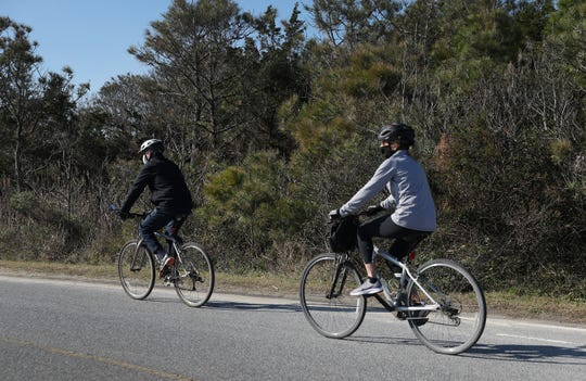 U.S. President Elect Joe Biden and his wife Jill Biden take a bike ride through Cape Henlopen State Park on November 14, 2020 in Lewes, Delaware. President Elect Biden has been staying at a vacation home in Rehoboth Beach while working on his transition.