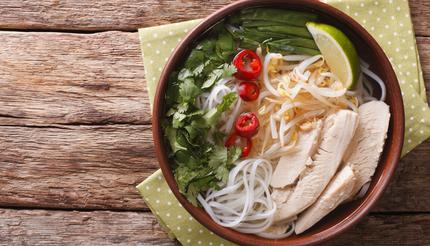 Vietnamese pho ga with chicken and rice noodles, bean sprouts and chillies