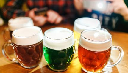 Five authentic crafted mugs of Czech beer in a Prague pub