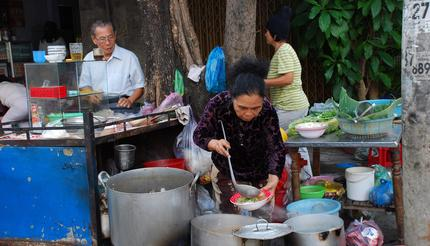 Cooking and selling traditional morning pho bo soup