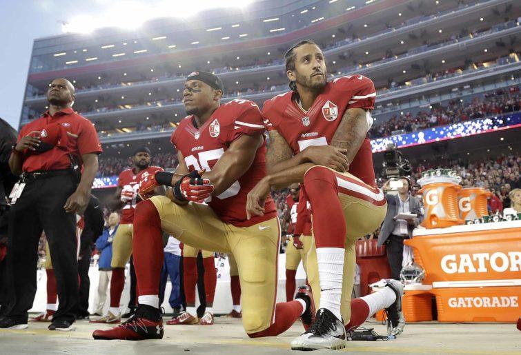 Colin Kaepernick kneels
