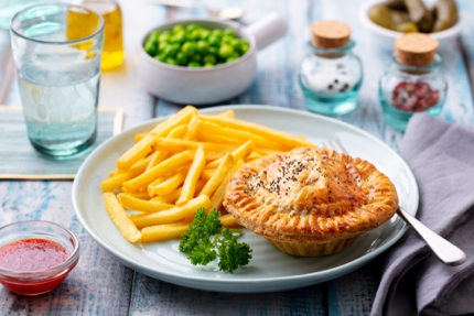 Enjoying a savoury pie and chips