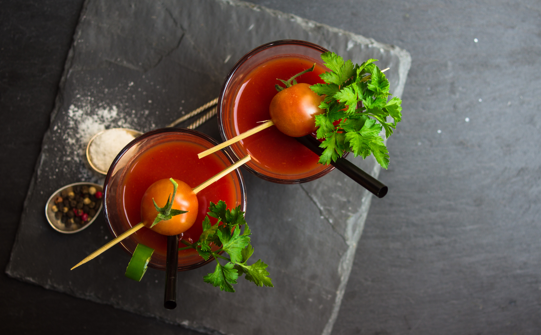 Fresh tomato juice with cherry tomatoes and chili pepper on rustic background
